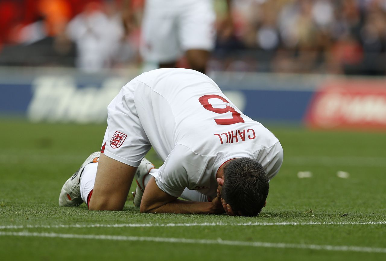 England's Gary Cahill lies on the field injured after being pushed into goalkeeper Joe Hart, not pictured, by Belgium's Dries Mertens, not pictured, during the international friendly soccer match between England and Belgium at Wembley Stadium in London, Saturday, June 2, 2012. (AP Photo/Kirsty Wigglesworth)