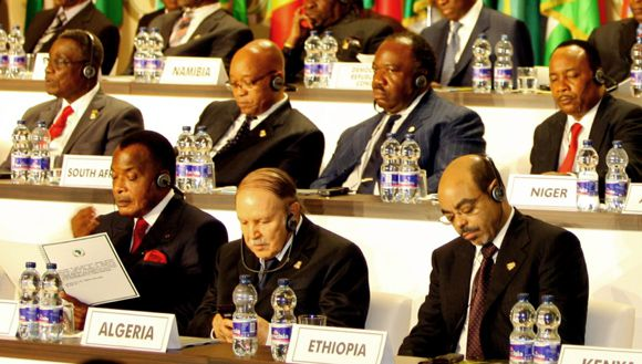 """The heads of state of African Union (AU) listen to an unseen speaker during the opening of the African Union's 17th summit on June 30, 2011 in Sipopo City, a city built especially for the occasion near the capital Malabo. Equatorial Guinea President Teodoro Obiang Nguema Africa should push for less foreign """"interference"""" in African affairs, including by financing more of the African Union costs. AFP PHOTO/ STR"""
