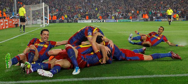 Caption: FC Barcelona's Pedro Rodriguez, unseen, celebrates his goal with team mates during a semi final, 2nd leg Champions League soccer match against Real Madrid at the Camp Nou stadium in Barcelona on Tuesday, May 3, 2011. (AP Photo/Andres Kudacki)