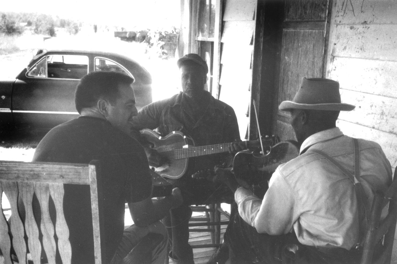 Alan Lomax, left, Miles Pratcher, center, Bob Pratcher, right, in Como, Mississippi on September 21, 1959. Lomax, a musical archivist and writer, recorded the bluegrass song