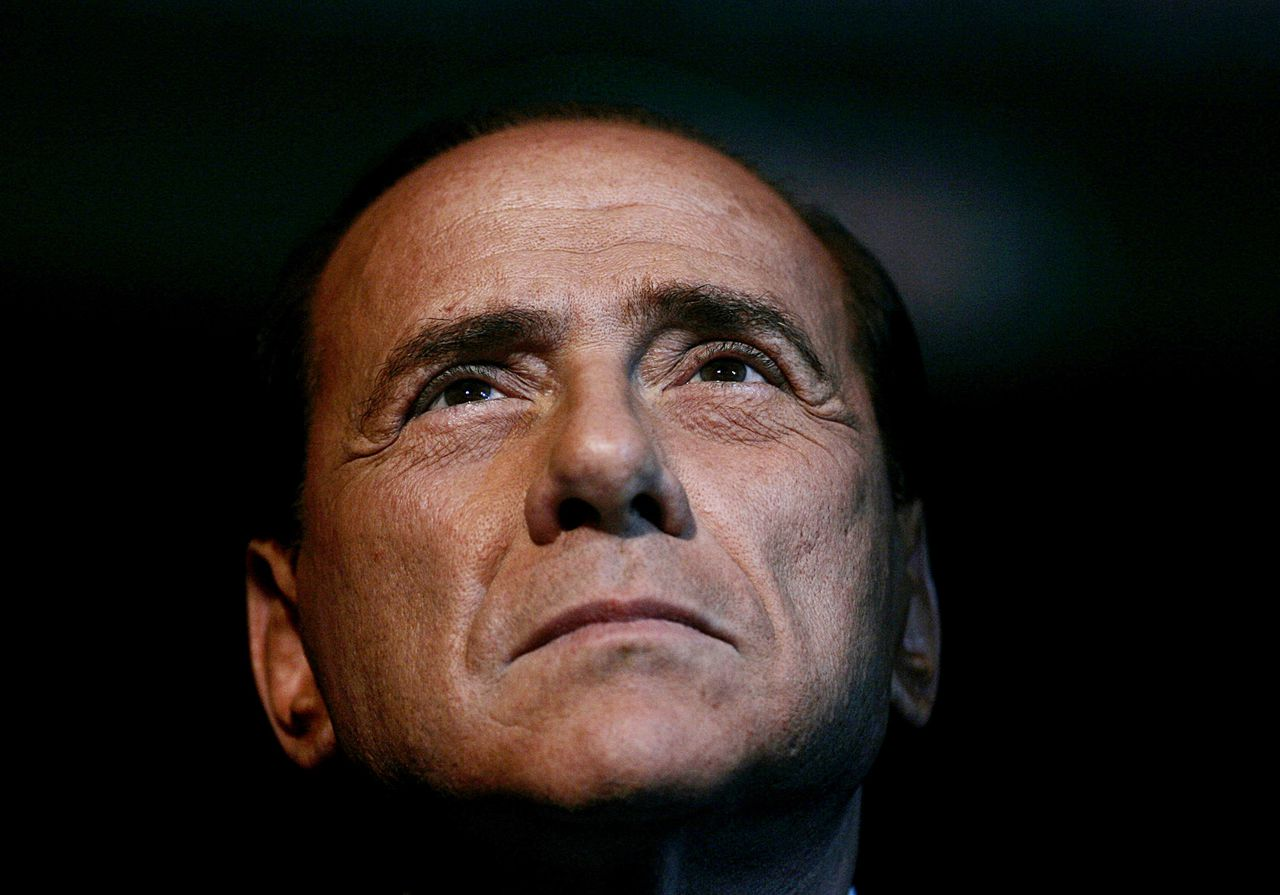 FILE - In this Friday, Feb. 3, 2006 file photo, Italian Premier Silvio Berlusconi attends an Italian Republican party program conference in Rome. Pressure mounted on Premier Silvio Berlusconi to resign so a new government could pass the economic reforms Italy needs to avoid financial disaster, as the country's borrowing rates spiked Monday, Nov. 7, 2011, and talk of early elections intensified. (AP Photo/Gregorio Borgia, File)