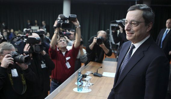 Mario Draghi, President of the European Central Bank approaches a press conference in Frankfurt, Germany, Thursday, Dec.8, 2011. The ECB announced to lower their key interest rate by 25 basis points to one percent. (AP Photo/Michael Probst)