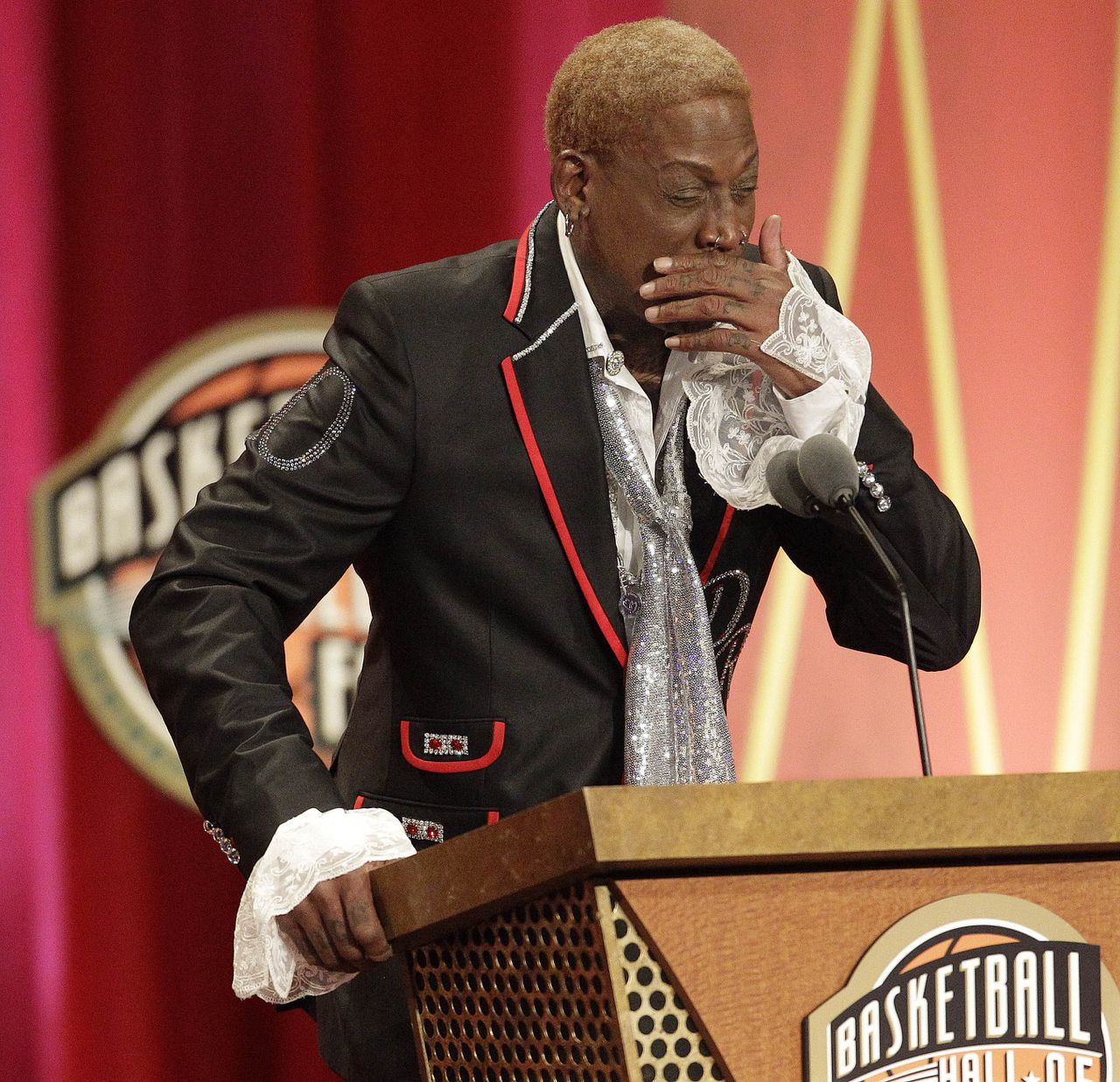FOR USE AS DESIRED, YEAR END PHOTOS - FILE -In this Aug. 12, 2011 file photo, Dennis Rodman becomes emotional during his address for his Basketball Hall of Fame enshrinement at a ceremony in Springfield, Mass. (AP Photo/Stephan Savoia, File)