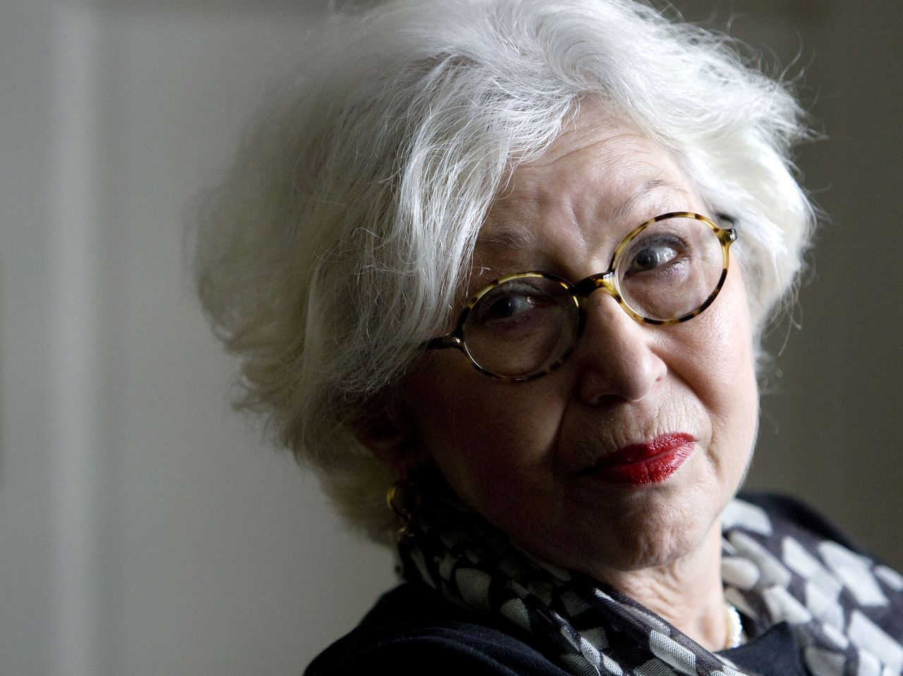 """FILE - In this March 12, 2010 file photo Berthe Meijer is seen during an interview with the Associated Press at her home in Amsterdam, Netherlands. Dutch Jewish author Berthe Meijer, whose life intersected tangentially with that of Anne Frank, has died. She was 74. Her husband, Gary Goldschneider, said Wednesday, July 11, 2012 that Meijer died of cancer on July 10. Meijer grew up on the same Amsterdam street where Frank attended a Montessori school. They were imprisoned in Bergen-Belsen at the same time, though Meijer was years younger. In 2010, Meijer published a memoir titled """"Life After Anne Frank,"""" describing her post-war fortunes as perhaps resembling what might have happened to Frank, had she lived. (AP Photo/Evert Elzinga, File)"""