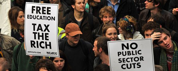 Caption: Student demonstrators carry banners as they march against cuts in tuition funding in London on November 9, 2011. Thousands of students headed to London on November 9 to march against cuts to higher education funding, as a huge police operation sought to head off any repeat of violent protests one year ago. AFP PHOTO / BEN STANSALL