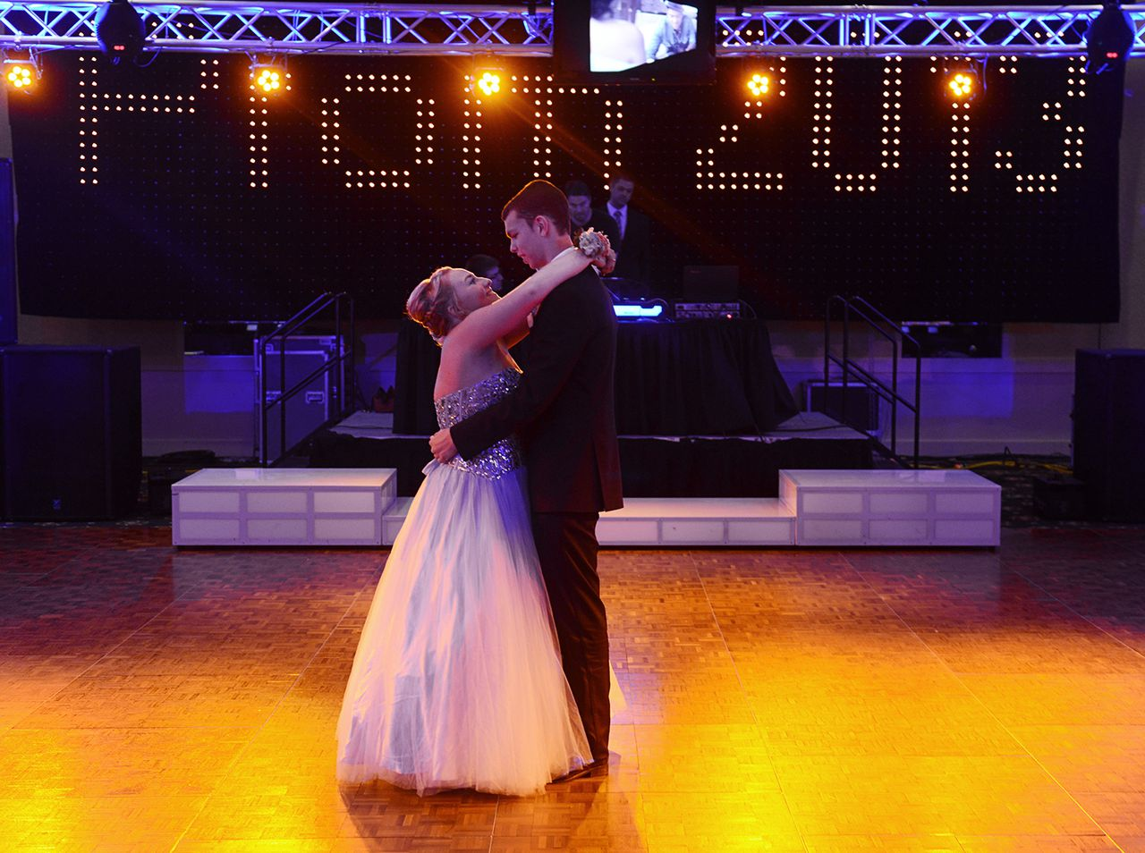 Katlyn Gardner,17 of Middleburg Heights and Pat Ryan,16 of Brooklyn dance in the ball room at the Lacentre in Westlake for the Midpark Prom on Friday night. (Kyle Lanzer/Sun News)