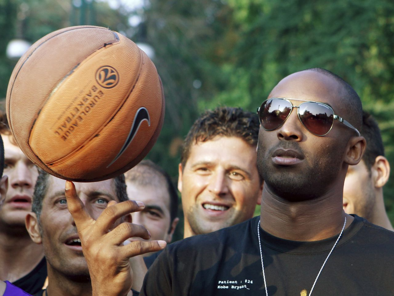 """U.S. basketball star Kobe Bryant plays with a ball during a sponsor's appearance in Milan, Italy, Wednesday, Sept. 28, 2011. Bryant said it's """"very possible"""" he will play in Italy during the NBA lockout, adding the country is like home because he spent part of his childhood there. (AP Photo/Luca Bruno)"""