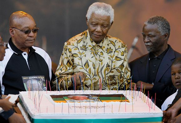 Caption: File-In this Aug. 2 2008 file photo, former South African President Nelson Mandela, flanked by African President Thabo Mbeki, right, and ANC President Jacob Zuma, left, cuts a birthday cake at the Loftus Versfeld stadium in Pretoria, South Africa for a celebration of Mandela's 90th birthday, organized by the African National Congress. Against all odds, the party of Nelson Mandela which has transformed a nation where just 20 years ago black South Africans could not vote, and beaches and restaurants were reserved for whites only, is celebrating its 100th anniversary in Bloemfontein Sunday Jan 8 2012.(AP Photo/Jerome Delay, file)