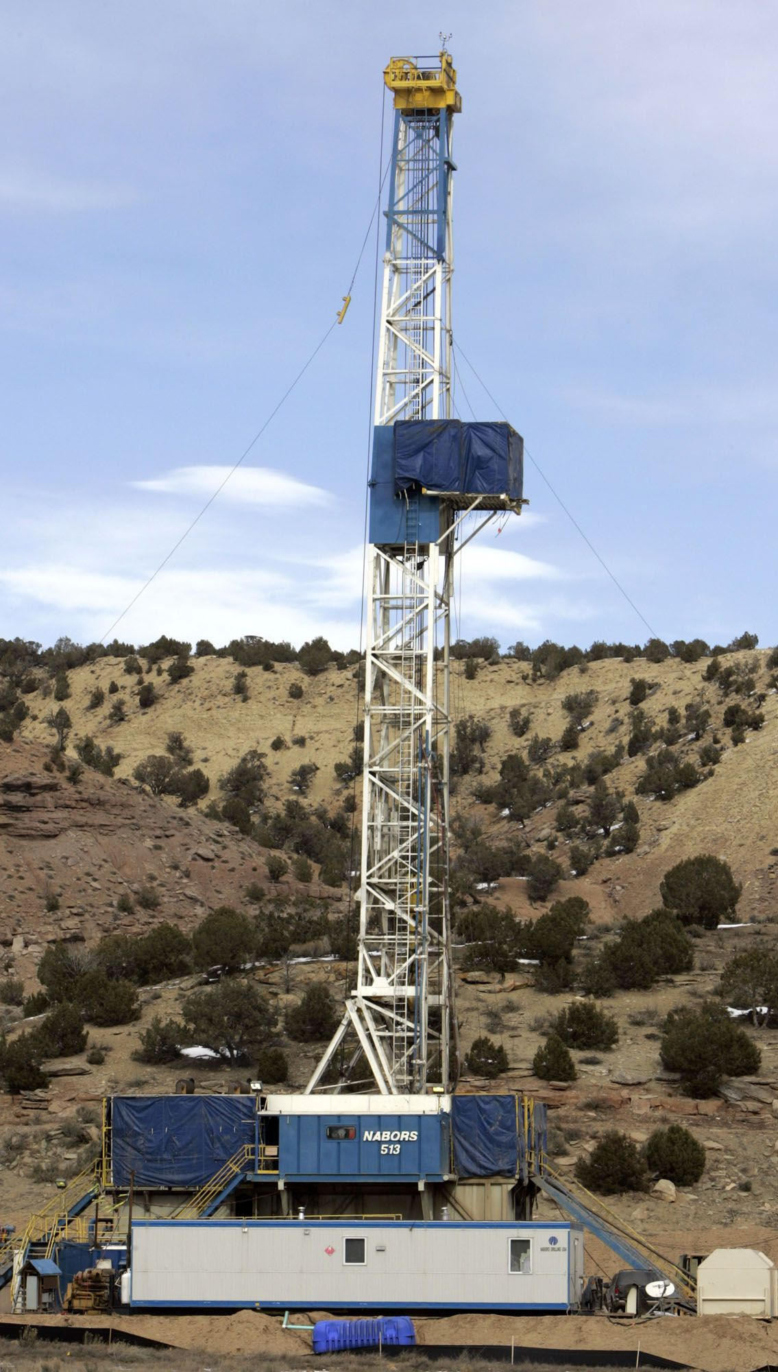 ** ADVANCE FOR WEEKEND EDITIONS, MARCH 4-5 ** A drilling rig stands over a natural gas well near Interstate 70 west of Rifle, Colo., in this photograph taken on Wednesday, Jan. 25, 2006. Energy companies hunting for natural gas are snapping up land all around them, either through old oil shale claims or through federal auctions. (AP Photo/David Zalubowski)