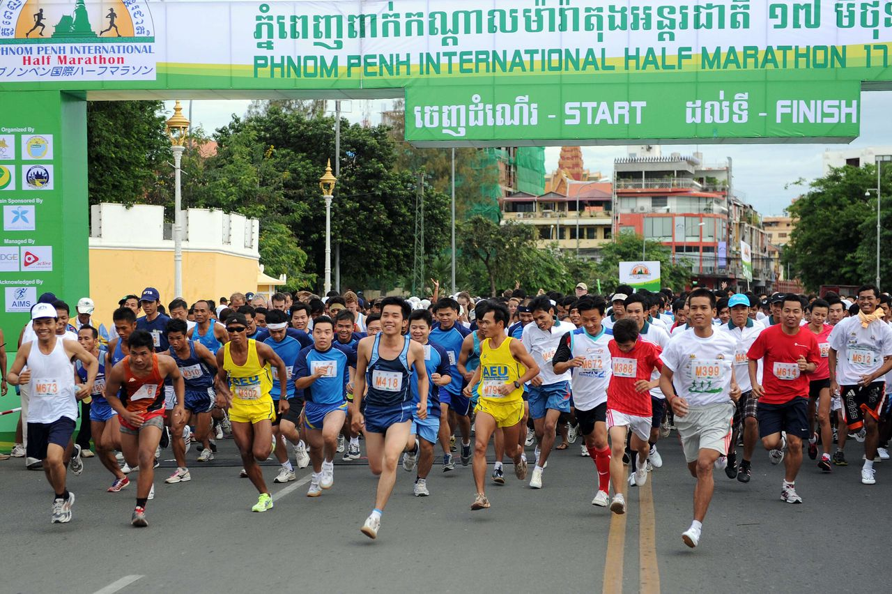 Competitors run during the international half marathon in front of the Royal Palace in Phnom Penh on June 17, 2012. Cambodia celebrates former Queen Norodom Monineath Sihanouk's birthday with the international half marathon. AFP PHOTO/ TANG CHHIN SOTHY