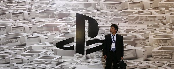 A visitor stands in front of a poster of the Sony Playstation logo during the Electronic Entertainment Expo in Los Angeles in this June 2, 2009 file photo. Sony suffered a massive breach in its video game online network that led to the theft of names, addresses and possibly credit card data belonging to 77 million user accounts, the company said on its U.S. PlayStation blog on April 26, 2011, in what is one of the largest-ever Internet security break-ins. REUTERS/Mario Anzuoni/Files (UNITED STATES - Tags: SCI TECH BUSINESS ENTERTAINMENT CRIME LAW)