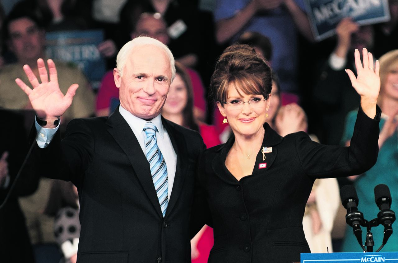 """In this undated image released by HBO, Ed Harris portrays Arizona Sen. John McCain, left, and Julianne Moore portrays Sarah Palin, in a scene from """"Game Change,"""" a film about the 2008 presidential race, premiering Saturday, March 10, at 9 p.m. on HBO. (AP Photo/HBO, Phil Caruso)"""