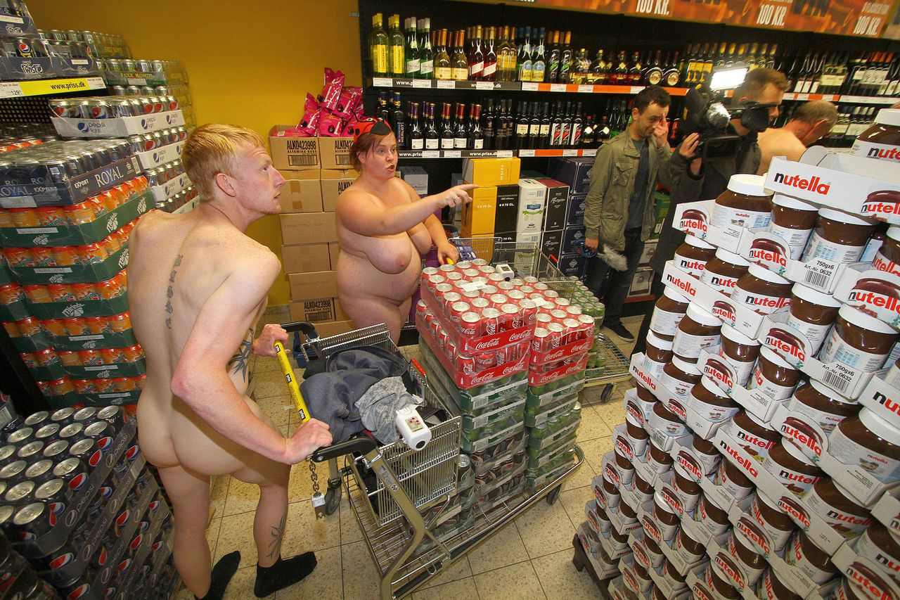 Naked customers push their carts through a supermarket during its opening on June 16, 2012 in Suederluegum, northern Germany, near the Danish border. The owner of the store promised free shopping limited at 2,000 Danish krones (circa 270 euro) to the first 100 clients coming to the shop's inauguration - on the condition that they are naked. AFP PHOTO SEBASTIAN IWERSEN GERMANY OUT