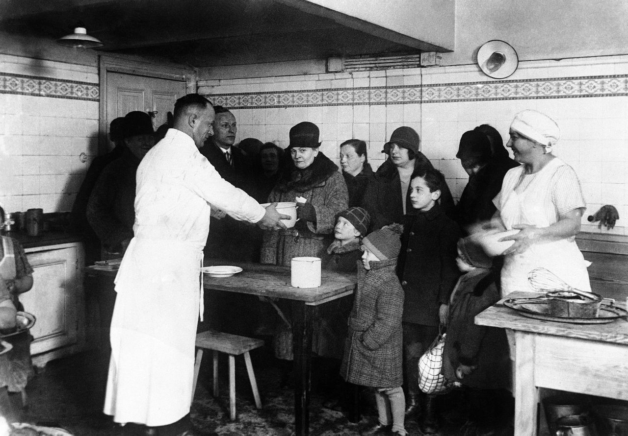 German people receiving their daily meal from a kitchen in Berlin, Germany around July 15, 1931. (AP Photo)