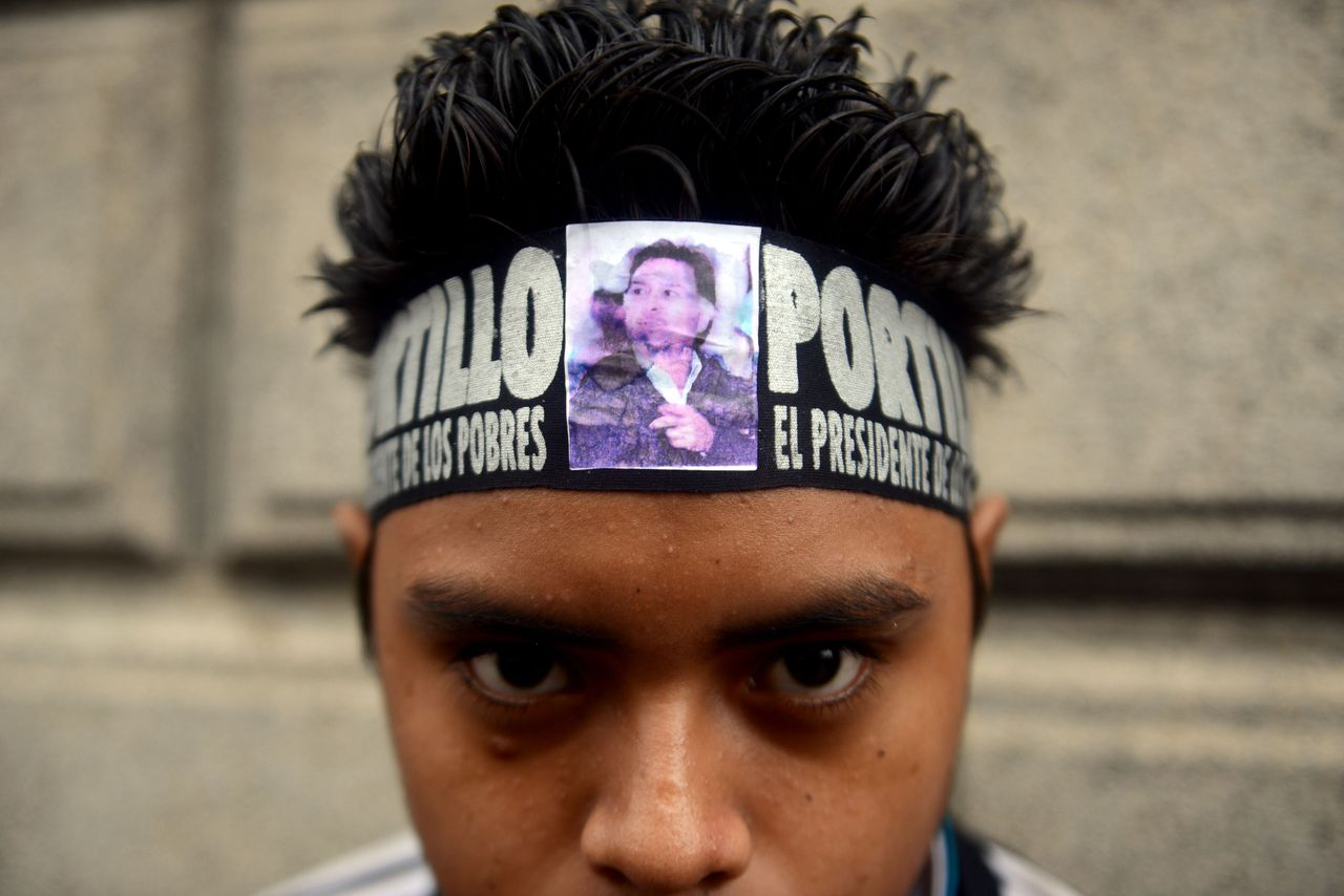 A supporter of former Guatemalan President (2000-2004) Alfonso Portillo stands a protest outside the Congress of Guatemala against his extradition to the United States in Guatemala city on May 29,2013. Portillo was extradited to the United States on May 24 and was indicted May 28 on charges of laundering tens of millions of US dollars of his country's funds through US banks. TOPSHOTS/AFP PHOTO / Johan ORDONEZ