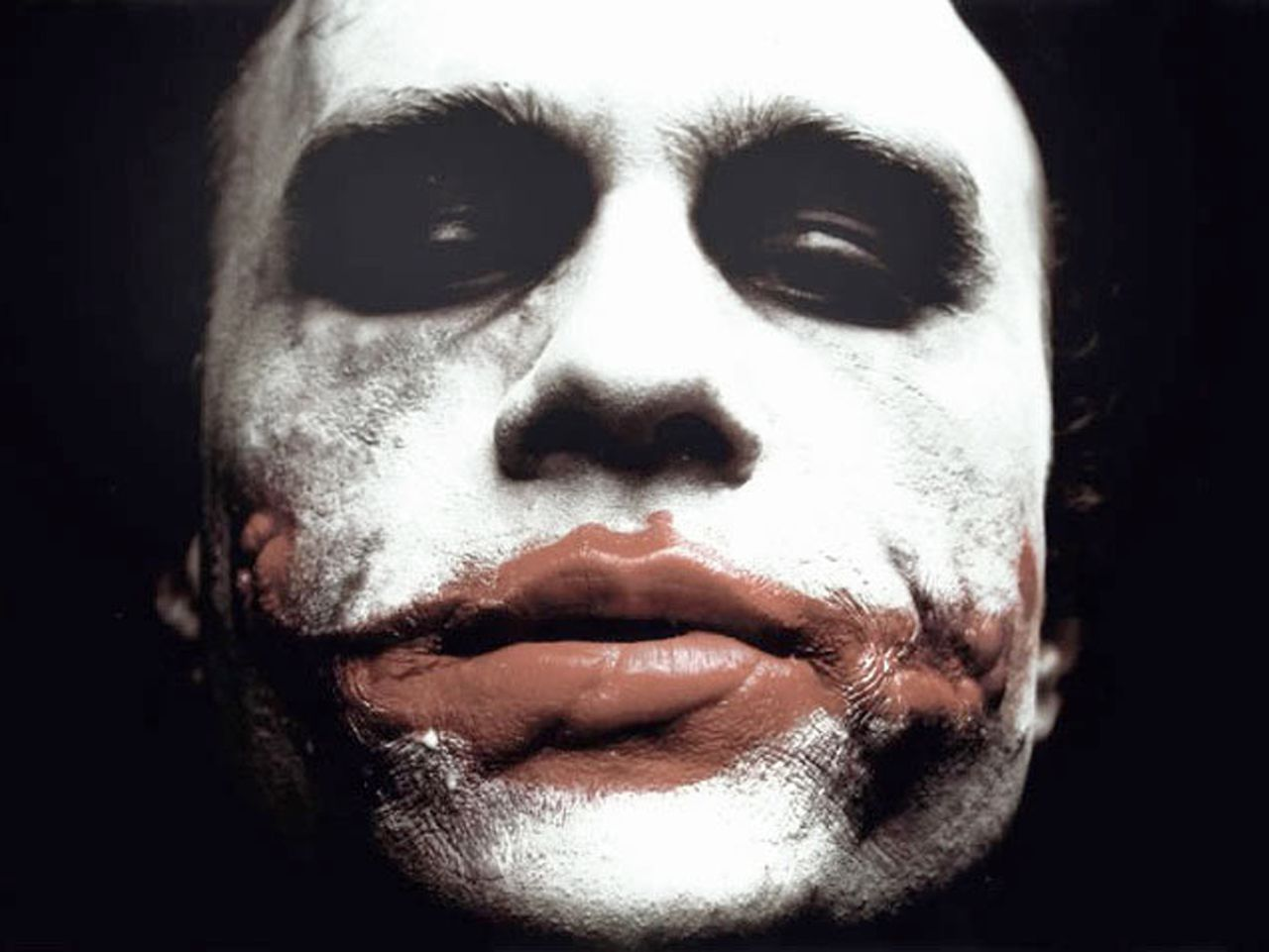 """Actor Heath Ledger is shown in an undated publicity photo as The Joker in Warner Bros. Pictures' and Legendary Pictures' action drama """"The Dark Knight."""" Ledger was found dead in his New York apartment January 22, 2008, New York City police said. REUTERS/Warner Bros./Handout. NO SALES. NO ARCHIVES. EDITORIAL USE ONLY. NOT FOR SALE FOR MARKETING OR ADVERTISING CAMPAIGNS."""