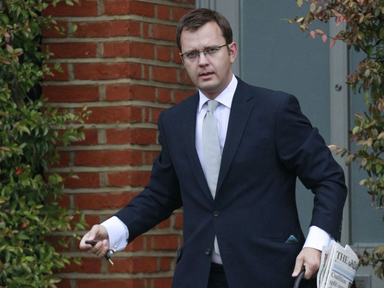 Former News of the World newspaper editor and Prime Minister David Cameron's director of communications, Andy Coulson, is seen leaving his home in Dulwich, southeast London in this September 8, 2010 file photograph. Coulson resigned as Cameron's director of Communications, Downing Street said, on January 21, 2011. REUTERS/Luke MacGregor/Files (BRITAIN - Tags: POLITICS SOCIETY)