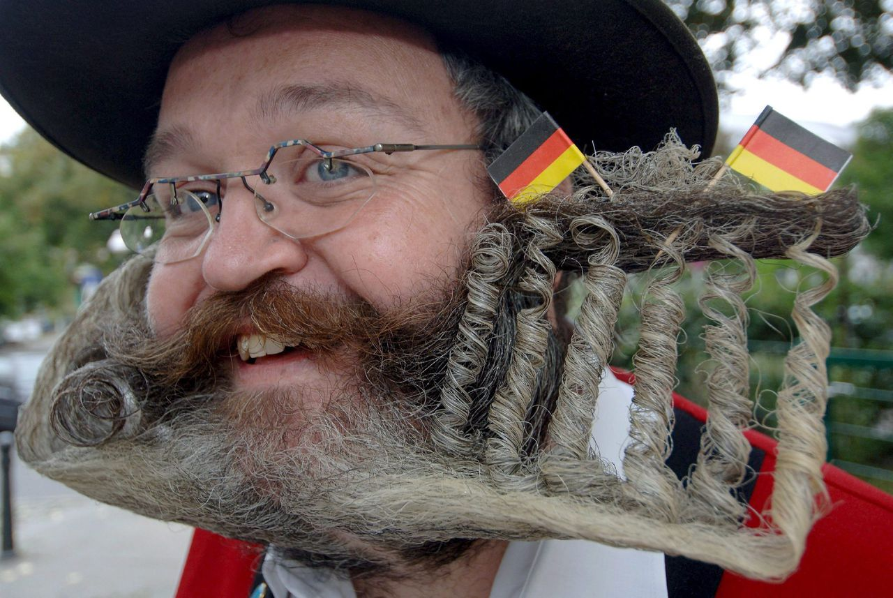 epa00542530 Elmar Weisser twirled his full beard to a Brandenburg Gate during the Mustache World Championships in Berlin, Germany, Saturday 01 October 2005. The organisers expect 250 bearded people from all over the world. EPA/TIM BRAKEMEIER