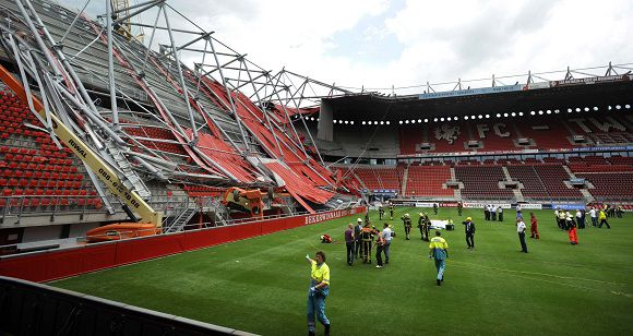 The soccer stadium of FC Twente Enschede is seen after a part of the newly constructed roof collapsed in Enschede July 7, 2011. Part of the Dutch soccer stadium under renovation collapsed on Thursday, trapping and injuring an unknown number of people under the rubble. The incident was probably related to construction work at the stadium, police said. REUTERS/Eric Brinkhorst (NETHERLANDS - Tags: SPORT SOCCER BUSINESS CONSTRUCTION DISASTER) NETHERLANDS OUT. NO COMMERCIAL OR EDITORIAL SALES IN NETHERLANDS