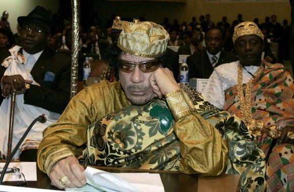 Libyan leader and the new chairman of the African Union, Muammar Gaddafi, attends the opening session of the 12th African Union Summit in Ethiopia's capital Addis Ababa in this February 2, 2009 file photo. Libyan government tanks and snipers put up scattered, last-ditch resistance in Tripoli on August 22, 2011 after rebels swept into the heart of the capital, cheered on by crowds hailing the end of Gaddafi's 42 years in power. REUTERS/Antony Njuguna/Files (ETHIOPIA - Tags: CONFLICT POLITICS PROFILE MILITARY)