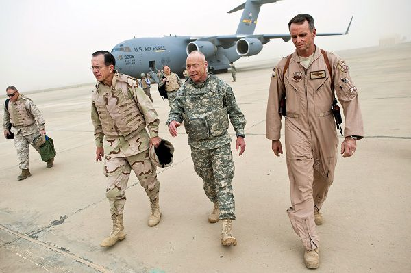 In this image released by the U.S. Department of Defense and taken on Thursday, April 21, 2011, Navy Adm. Mike Mullen, chairman of the Joint Chiefs of Staff, center left, is welcomed to Baghdad International Airport by Army Lt. Gen. Frank Helmick, deputy commanding general for Operations, United States Forces - Iraq, center, and Brig. Gen. Anthony J. Rock, director, Iraq Training and Advisory Mission - Air, U.S. Forces - Iraq, right. Iraq's prime minister has told the top U.S. military officer that Iraqi forces are able to maintain security in their own country, as discussions intensify over whether to keep any U.S. forces in Iraq past this year. (AP Photo/DOD,Specialist 1st Class Chad J. McNeeley, HO)
