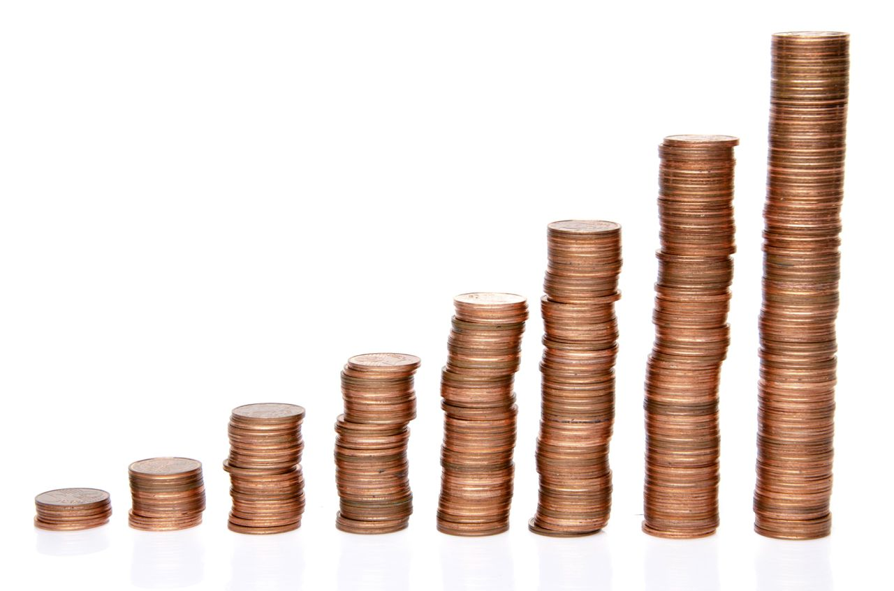 Stacks of copper coins, isolated on white