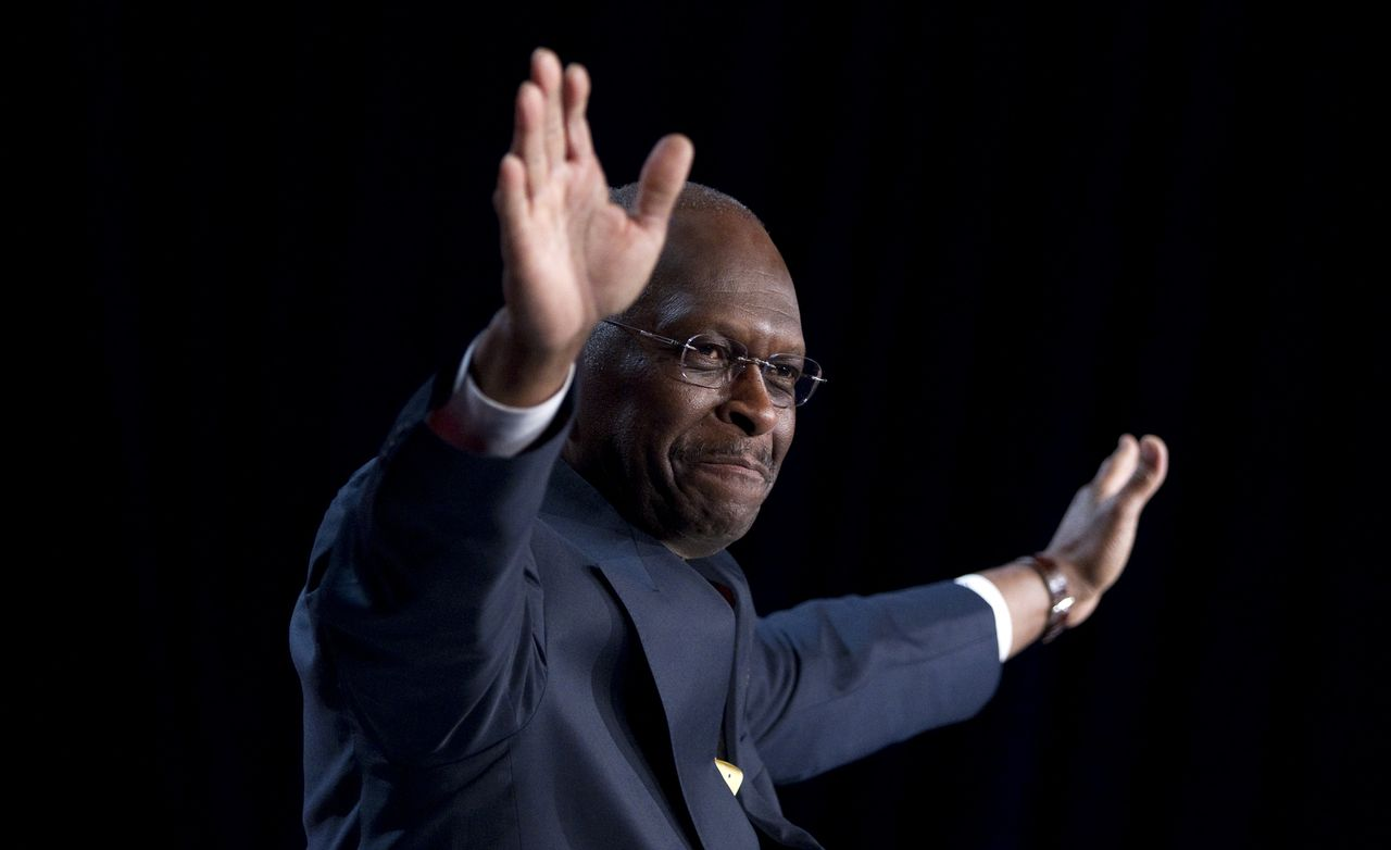 Republican presidential hopeful Herman Cain gestures during a speech at the Values Voter Summit on Friday, Oct. 7, 2011, in Washington. (AP Photo/Evan Vucci)