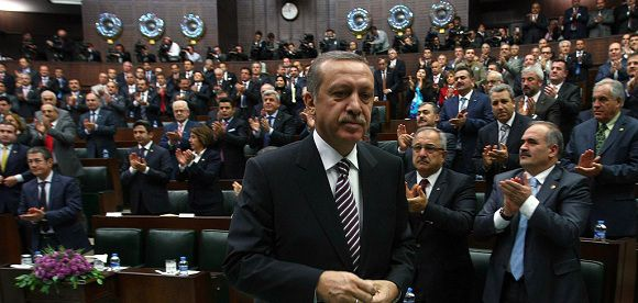 "Caption: Turkey's Prime Minister Recep Tayyip Erdogan leaves after addressing members of Parliament from his ruling AK Party during a meeting at the parliament in Ankara, on November 15, 2011. Turkey does not expect anymore Syria to respond to the demands of the international community to stop violence and initiate democratic reforms, Prime Minister Recep Tayyip Erdogan said on November 15. ""It is not among our expectations anymore that the government of Assad would demonstrate the desired leadership, which is honest, persuasive, brave and determined... No one expects him anymore to respond to the demands of the international community,"" Erdogan told his lawmakers in the parliament. AFP PHOTO/ADEM ALTAN"