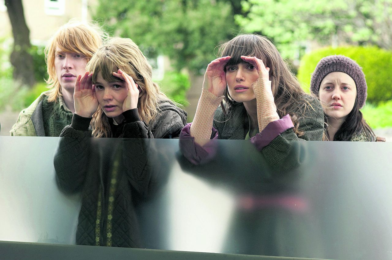 """In this film publicity image released by Fox Searchlight, Carey Mulligan, left, and Keira Knightley are shown in a scene from """"Never let Me Go."""" (AP Photo/Fox Searchlight, Alex Bailey)"""