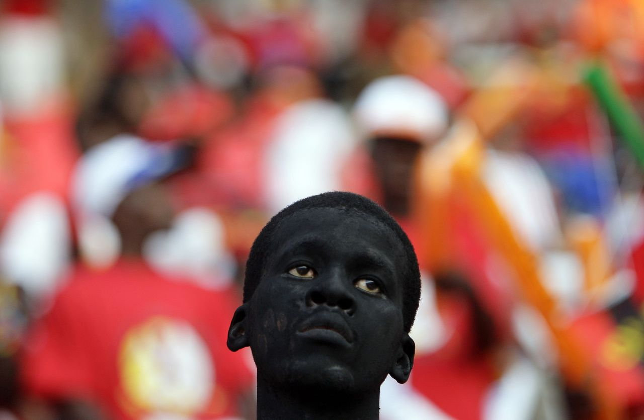 An Angolan supporter with painted face looks on before Angola's opening match against Mali in the African Nations Cup soccer tournament in Luanda January 10, 2010. REUTERS/Amr Abdallah Dalsh (ANGOLA - Tags: SPORT SOCCER IMAGES OF THE DAY)
