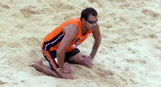 during a beach volleyball match at the 2012 Summer Olympics, Sunday, July 29, 2012, in London. (AP Photo/Dave Martin)