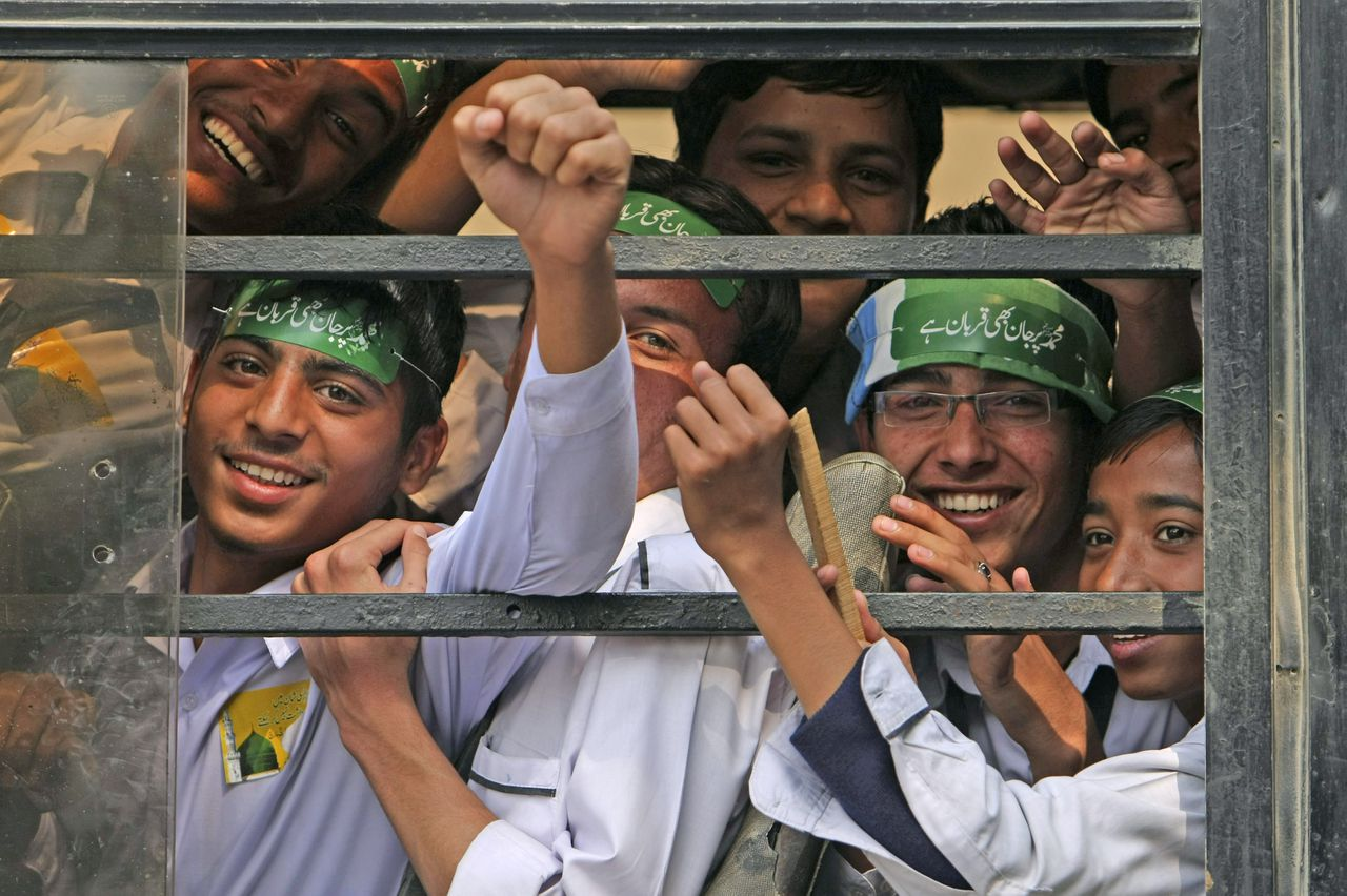 Pakistani students look out of a bus' window after taking part in a rally to protest against any attempts to modify blasphemy laws, in Karachi, Pakistan, Thursday, Jan. 20, 2011. Around two thousand school children gathered in Pakistan's largest city on Thursday showing their support for the country's blasphemy laws. (AP Photo/Fareed Khan)