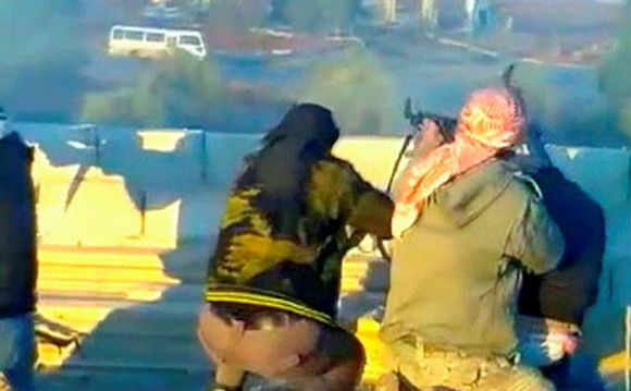 """This still image taken from video off a social media website uploaded as December 28, 2011, shows purported members of """"Free Syrian Army"""" (military defectors) firing at a convoy of government security buses in the village of Dael, near Deraa REUTERS/via Reuters Tv/Handout (SYRIA - Tags: POLITICS CIVIL UNREST) FOR EDITORIAL USE ONLY. NOT FOR SALE FOR MARKETING OR ADVERTISING CAMPAIGNS. THIS IMAGE HAS BEEN SUPPLIED BY A THIRD PARTY. IT IS DISTRIBUTED, EXACTLY AS RECEIVED BY REUTERS, AS A SERVICE TO CLIENTS"""