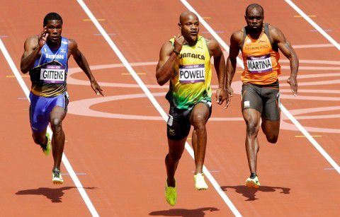 rom left, Barbados' Ramon Gittens, Jamaica's Asafa Powell and Netherlands' Churandy Martina compete in a men's 100-meter heat during the athletics in the Olympic Stadium at the 2012 Summer Olympics, London, Saturday, Aug. 4, 2012. (AP Photo/Michael Sohn)