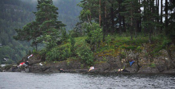 In this photo taken by Vergard M. Aas, a Norwegian crime reporter who responded to the scene of a mass shooting on Utoya Island, Norway, victims lie near the shoreline approximately one hour after police say a man dressed as a police officer gunned down youths as they ran and even swam for their lives at a camp which was organized by the youth wing of the ruling Labor Party, Friday July 22, 2011. Police say the suspect in this shooting set off a fatal explosion hours earlier in the Norwegian capital of Oslo, (AP Photo/Presse 3.0, Vegard M. Aas)