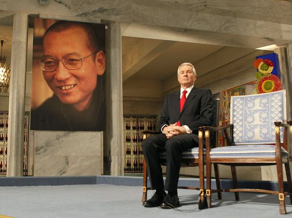 "Norwegian Nobel committee chairman Thorbjoern Jagland sits next to an empty chair where this year's Nobel Peace Prize winner jailed Chinese dissident Liu Xiaobo should have sat, during the ceremony at Oslo City Hall December 10, 2010. Chinese dissident Liu Xiaobo was awarded the Nobel Peace Prize in an Oslo ceremony derided by Beijing as a farce, and dedicated it from his prison cell to the ""lost souls"" of the 1989 Tiananmen Square crackdown. REUTERS/Heiko Junge/Scanpix Norway/Pool (NORWAY - Tags: POLITICS CIVIL UNREST ANNIVERSARY) NO COMMERCIAL OR BOOK SALES. NORWAY OUT. NO COMMERCIAL OR EDITORIAL SALES INNORWAY"