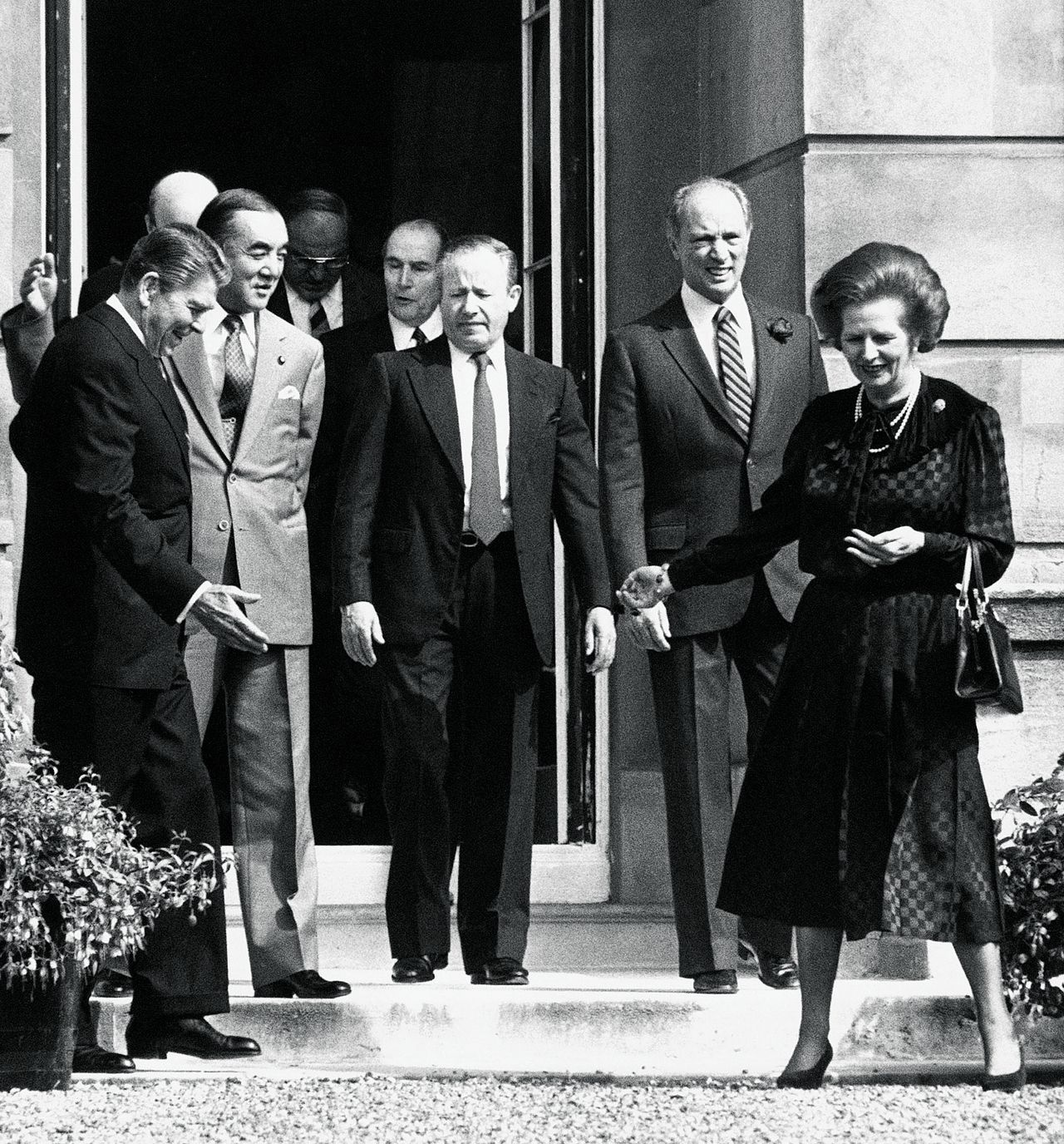British Prime Minister Margaret Thatcher leads conferees out into the sunshine to pose for photographers before the start of the session of the seven-nation Economic Summit meeting at London?s Lancaster House, June 9, 1984. Included are, front row, left to right: U.S. President Ronald Reagan; Japanese Prime Minister Yasuhiro Nakasone, Common Market Commissioner Gaston Thorn; Canadian Prime Minister Pierre Trudeau. French President Francois Mitterrand is behind Thorn. (AP Photo/Press Association)