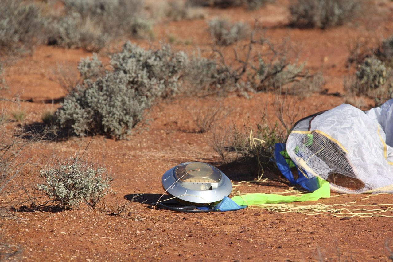 The Japanese Hayabusa Sample Return Capsule (SRC) is seen at Woomera rocket range in the Australian outback in this June 14, 2010 handout photo. A Japanese space probe has landed in the Australian outback after a seven-year voyage to an asteroid, safely returning a capsule containing a unique sample of dust, Japanese mission controllers said on Monday. REUTERS/JAXA/Handout (AUSTRALIA - Tags: SCI TECH POLITICS) FOR EDITORIAL USE ONLY. NOT FOR SALE FOR MARKETING OR ADVERTISING CAMPAIGNS
