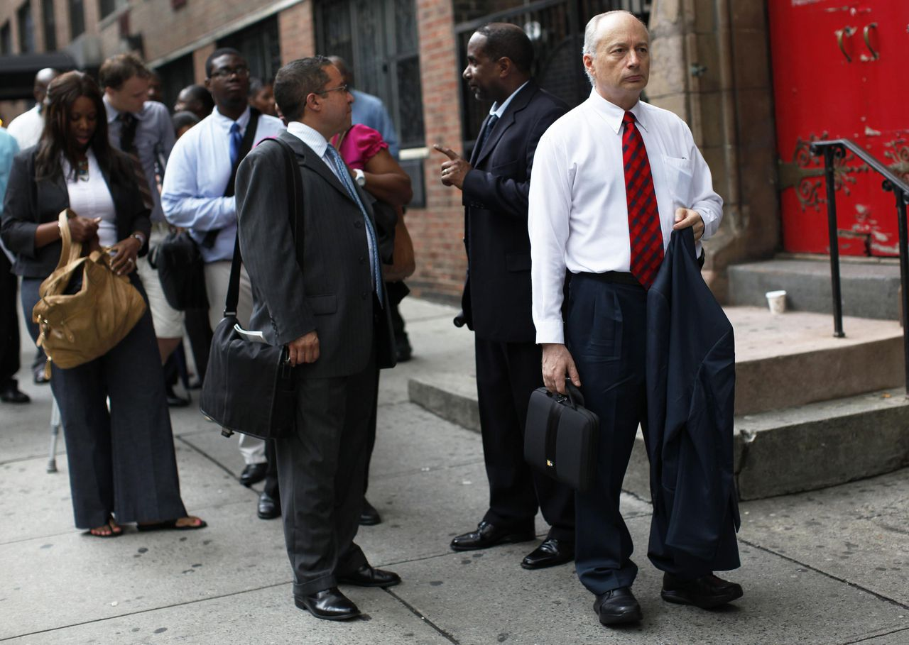 A man waits in line with others to enter a job fair in New York August 15, 2011. U.S. President Barack Obama began a bus tour of the U.S. Midwest focused on jobs and the economy on Monday, aiming to leave behind doubts about his leadership that could dent his 2012 re-election prospects. REUTERS/Shannon Stapleton (UNITED STATES - Tags: EMPLOYMENT BUSINESS POLITICS)