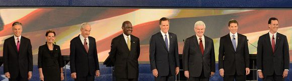 Caption: From left, Republican presidential candidates, Jon Huntsman, Former Governor of Utah, Michele Bachmann, U.S. Representative from Minnesota, Ron Paul, U.S. Representative from Texas, Herman Cain, Businessman, Mitt Romney, Former Governor of Massachusetts, Newt Gingrich, Former Speaker of House, Rick Perry, Texas Governor, and Rick Santorum, Former U.S. Senator, prepare to speak at the CBS News/National Journal foreign policy debate at the Benjamin Johnson Arena, Saturday, Nov. 12, 2011 in Spartanburg, S.C. (AP Photo/Richard Shiro)