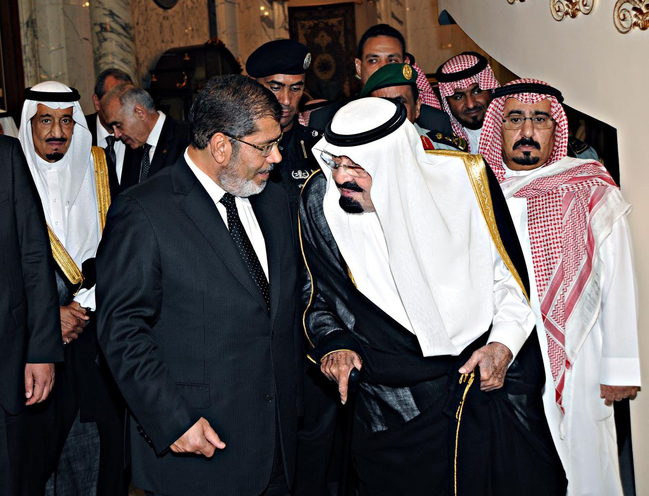 Saudi Arabia's King Abdullah (2nd R) speaks to Egypt's President Mohamed Mursi on his arrival at the Royal Palace in Jeddah airport July 11, 2012. REUTERS/Saudi Press Agency/Handout (SAUDI ARABIA - Tags: POLITICS ROYALS) FOR EDITORIAL USE ONLY. NOT FOR SALE FOR MARKETING OR ADVERTISING CAMPAIGNS. THIS IMAGE HAS BEEN SUPPLIED BY A THIRD PARTY. IT IS DISTRIBUTED, EXACTLY AS RECEIVED BY REUTERS, AS A SERVICE TO CLIENTS
