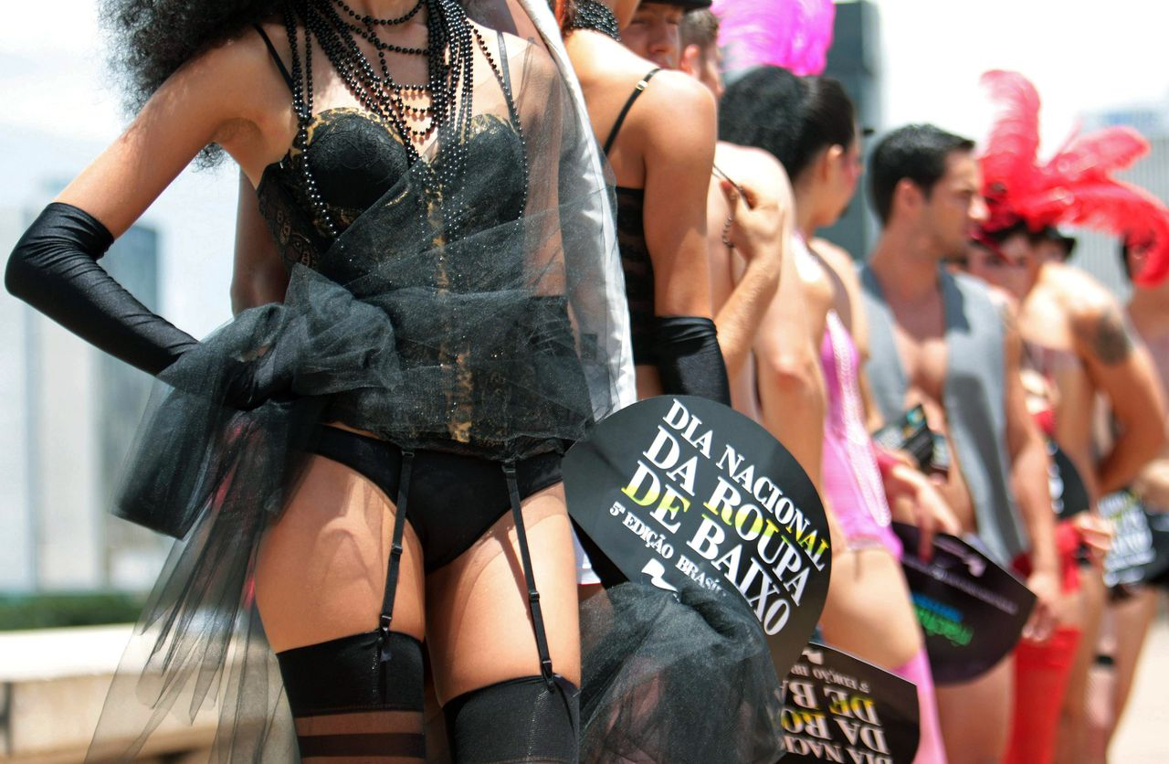 """Models parade in a street in downtown Brasilia during the """"Lingerie Day"""", on March 1, 2011. AFP PHOTO/Pedro Santana"""