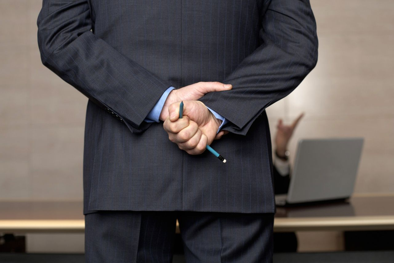 Businessman holding a broken pencil in his hand --- Image by © Stock4B/Corbis