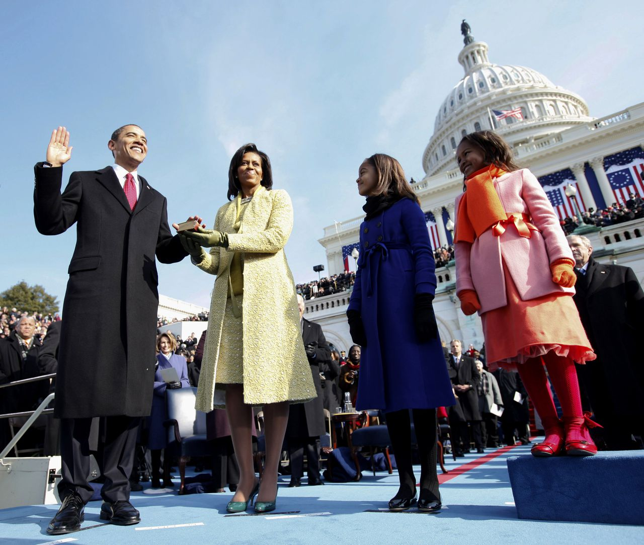 Barack Obama, left, takes the oath of office from Chief Justice John Roberts, not seen, as his wife Michelle, holds the Lincoln Bible and daughters Sasha, right and Malia, watch at the U.S. Capitol in Washington, Tuesday, Jan. 20, 2009. (AP Photo/Chuck Kennedy, Pool)
