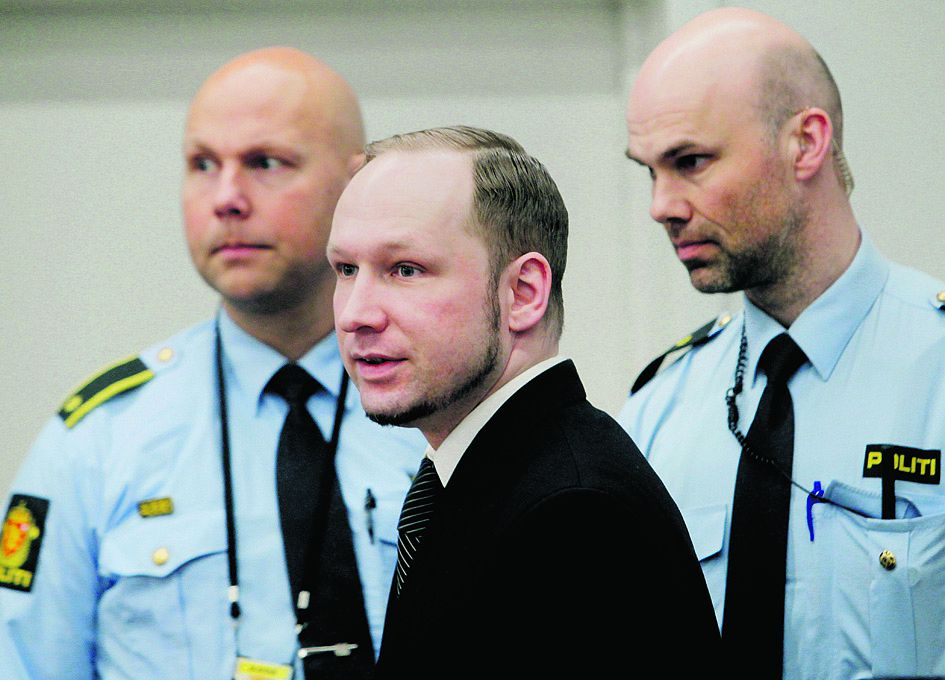 Defendant Anders Behring Breivik, centre, seen during the fourth day of proceedings in court in Oslo, Norway, Thursday April 19, 2012. Confessed mass killer Anders Behring Breivik testified Thursday that he had planned to capture and decapitate former Norwegian Prime Minister Gro Harlem Brundtland during his shooting massacre on Utoya island. (AP Photo / Erlend Aas)