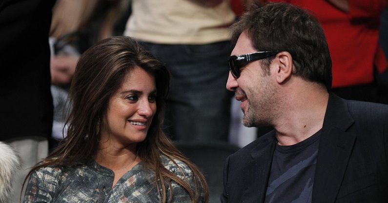 Actors Penelope Cruz and Javier Bardem attend the NBA basketball game between Miami Heat and Los Angeles Lakers at the Staples Center in Los Angeles December 25, 2010. REUTERS/Danny Moloshok (UNITED STATES - Tags: SPORT BASKETBALL ENTERTAINMENT IMAGES OF THE DAY)