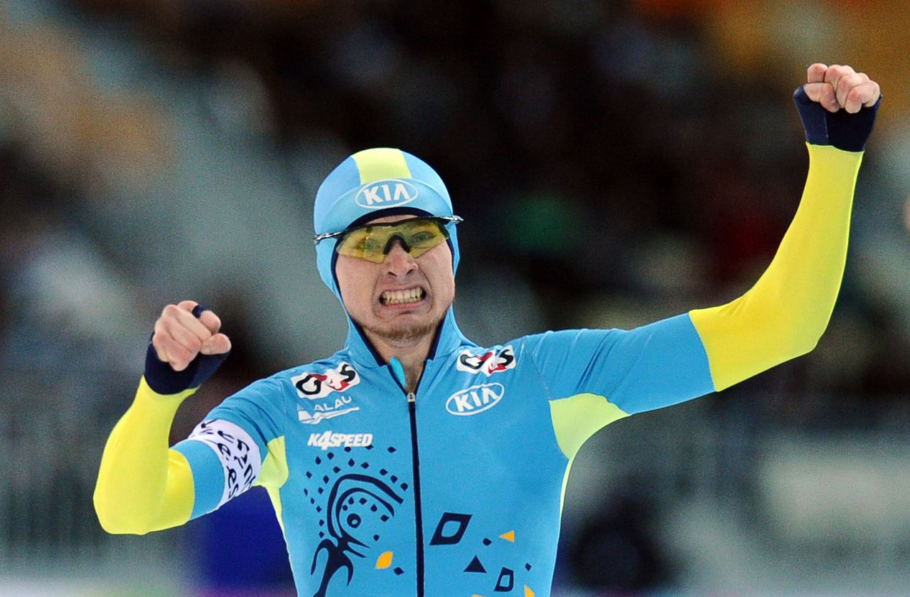 Kazakhstan's Denis Kuzin reacts as he competes in the 1000m men's event during the 2013 World Single Distances Speed Skating Championships in Sochi on March 22, 2013. Kuzin won the gold medal. AFP PHOTO / YURI KADOBNOV