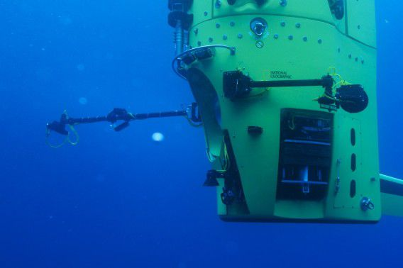 "Crews continue in-water testing of the Deepsea Challenger submersible that explorer and ""Titanic"" filmmaker James Cameron will pilot to the bottom of the Mariana Trench, in Australia in this handout photo released to Reuters March 25, 2012. The submersible is the centerpiece of the Deepsea Challenge, a joint scientific project by Cameron, the National Geographic Society and Rolex to conduct deep-ocean research. Cameron reached the ""Challenger Deep,"" the lowest point of the Mariana Trench, shortly before 8 a.m. local time Monday (6 p.m. EDT on Sunday). The depth was recorded at 35,756 feet (10,898 m). In his specially designed submersible Deepsea Challenger, Cameron plans to spend up to six hours on the Pacific Ocean seafloor, collecting samples for scientific research. REUTERS/National Geographic/Mark Thiessen/Handout (AUSTRALIA - Tags: SCIENCE TECHNOLOGY MARITIME SOCIETY ENTERTAINMENT) NO SALES. NO ARCHIVES. FOR EDITORIAL USE ONLY. NOT FOR SALE FOR MARKETING OR ADVERTISING CAMPAIGNS. THIS IMAGE HAS BEEN SUPPLIED BY A THIRD PARTY. IT IS DISTRIBUTED, EXACTLY AS RECEIVED BY REUTERS, AS A SERVICE TO CLIENTS"