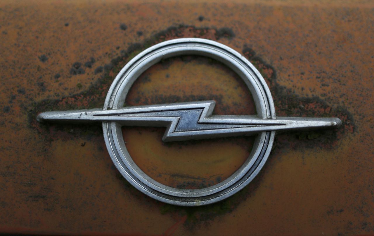 A vintage Opel car sign is seen at a Opel museum in Herne December 2, 2014. European carmaker Opel will close its Bochum plant by year-end 2014. Picture taken on December 2. REUTERS/Ina Fassbender (GERMANY - Tags: TRANSPORT BUSINESS EMPLOYMENT)