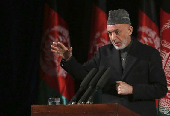 Afghan President Hamid Karzai gives a speech during an event to mark International Women's Day in Kabul March 10, 2013. REUTERS/Mohammad Ismail (AFGHANISTAN - Tags: POLITICS)